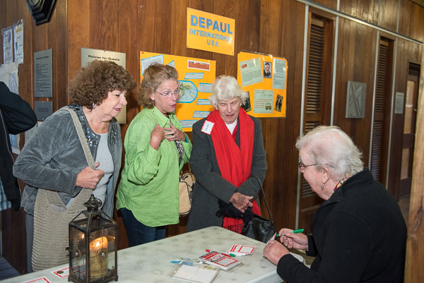 Sr. Enid Storey checking in guests.